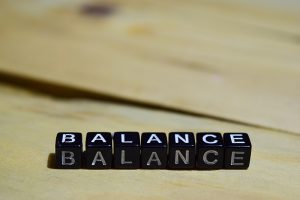 Balance written on wooden blocks. education and motivation concepts. Cross processed image on Wooden Background